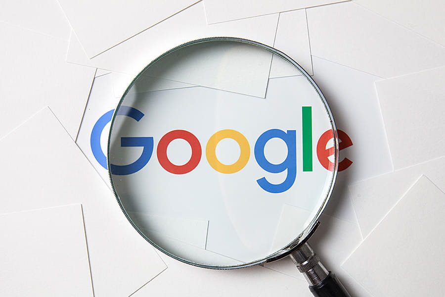 Google Logo under a Magnifying Glass